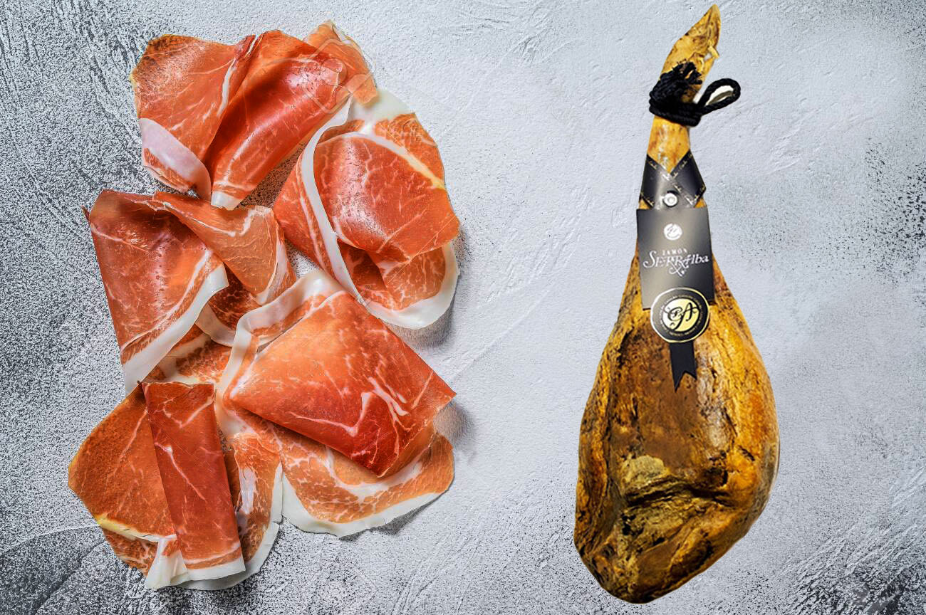 Spanish jamon Serrano, cured ham. White background. Top view. Copy space